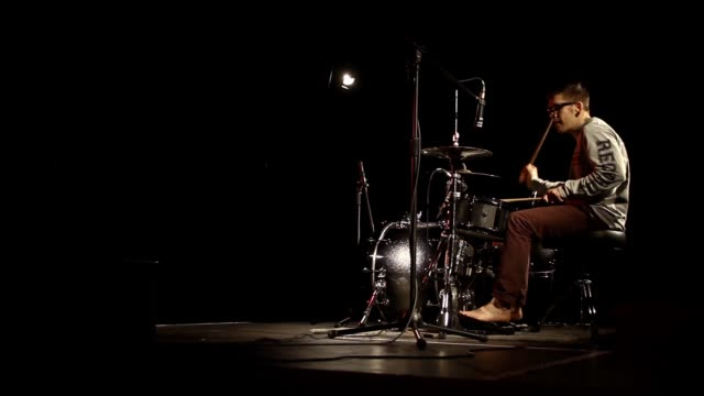 Drumming Live - Rock Drummer on Black Out Stage - Wide
