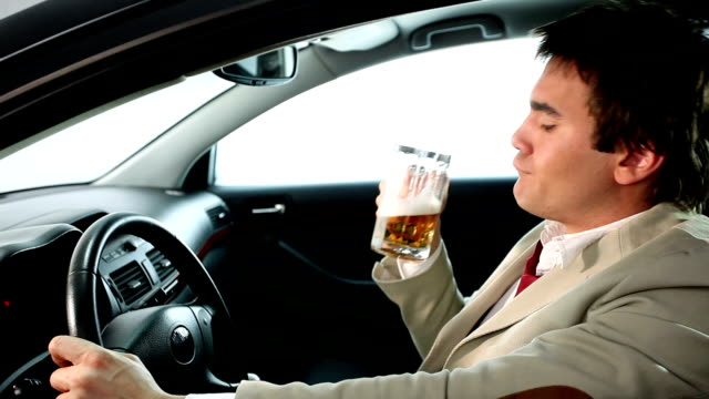 CHEERS! Drunk businessman in the car.