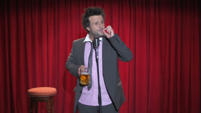 hd: drunk comedian pretending to smoke - comedian stock videos & royalty-free footage