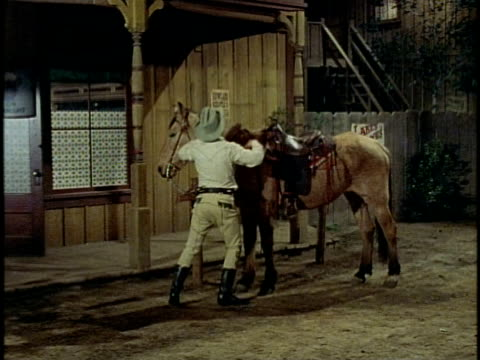 1974 montage drunk cowboy mounting horse, los angeles, california, usa - cowboy video stock e b–roll