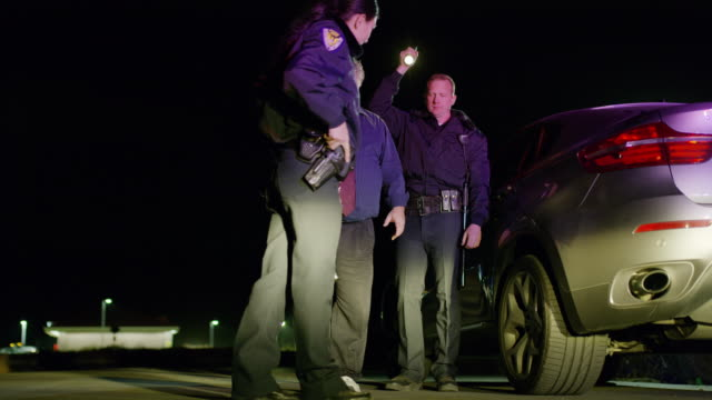Drunk driver failing sobriety test for police at night / Eagle Mountain, Utah, United States
