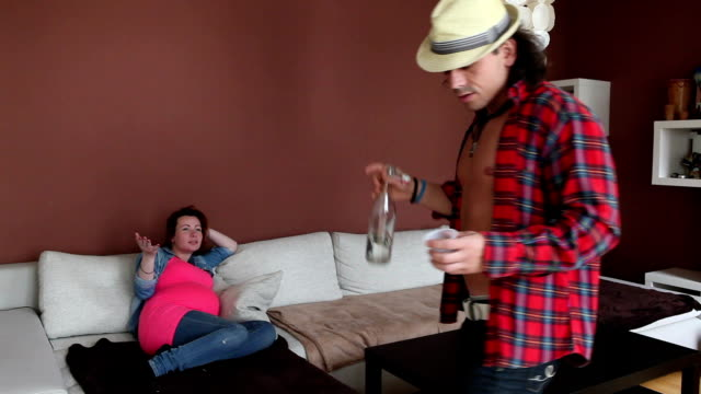 drunk man and pregnant woman - armchair stock videos & royalty-free footage