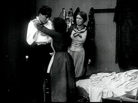 1916 B/W MONTAGE MS Drunk man pushing crying woman off in room, and staggering outside, 1880s / Santa Monica, California, USA