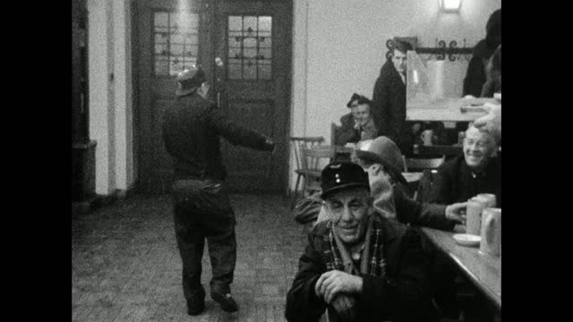 drunk man staggers to the door in munich's hofbräuhaus; 1966 - letterbox format stock videos & royalty-free footage