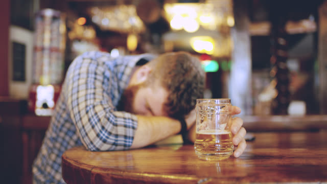 vídeos de stock e filmes b-roll de ds ms drunk men sleeping in the pub - dolly shot