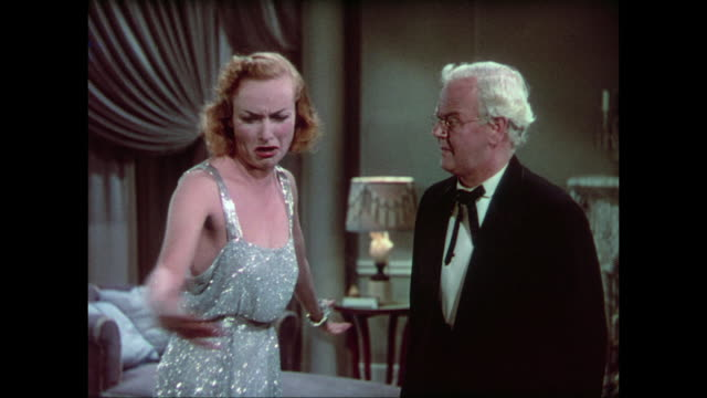 vídeos y material grabado en eventos de stock de 1937 drunk woman (carole lombard) cries and throws herself on the bed as doctor (charles winniger) scolds her and says 'shame on you!' - vergüenza