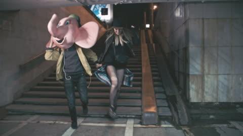 vídeos y material grabado en eventos de stock de drunk young people partying inside underground crossing - resistencia