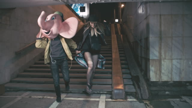 stockvideo's en b-roll-footage met drunk young people partying inside underground crossing - trappen