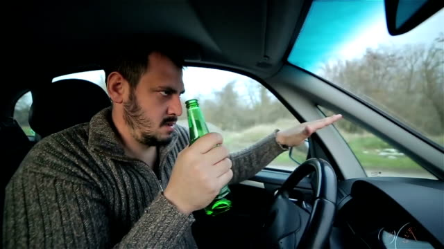 a drunken driver dancing in the car - crime stock videos and b-roll footage