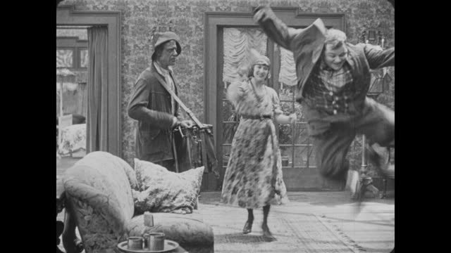 1918 drunken husband (fatty arbuckle) arrives home with gypsies, upsetting his wife - fatty arbuckle stock videos and b-roll footage