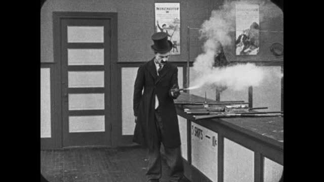 1921 drunken man upsets shooting gallery - schusswaffe stock-videos und b-roll-filmmaterial