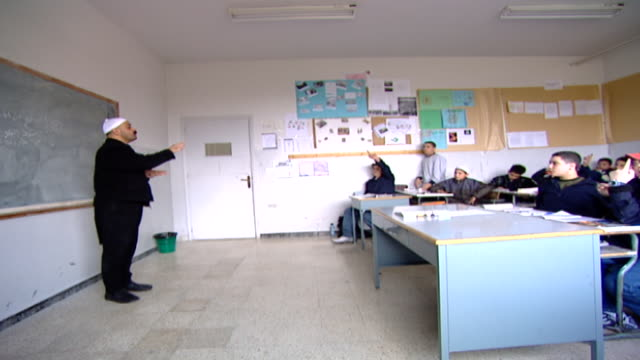 druze sheikh teacher lecturing a classroom of teenage boys. irfan is a druze religious school with five branches across lebanon that operate as ngos. - teenage boys stock videos & royalty-free footage
