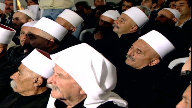 of druze sheikhs at a community meeting. the turban and dress of the sheikhs indicates they are uqqal, initiated druze. - turban stock videos & royalty-free footage