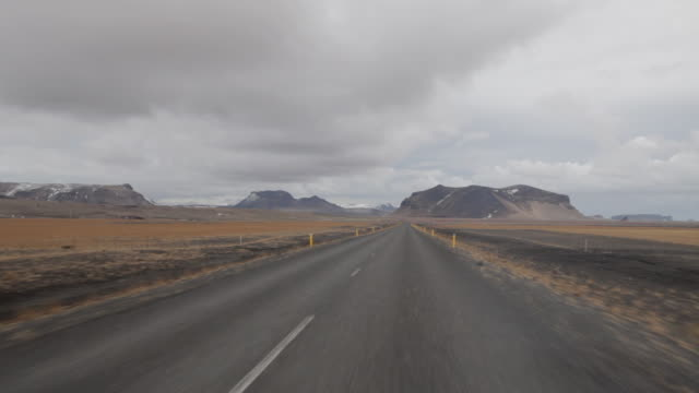 POV drving down a road through the South Coast in Iceland