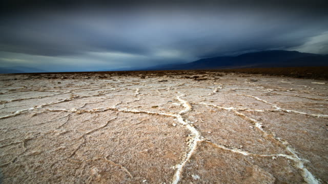 ms t/l pov dry cracked earth / death valley np, california, united states - death valley national park stock videos & royalty-free footage