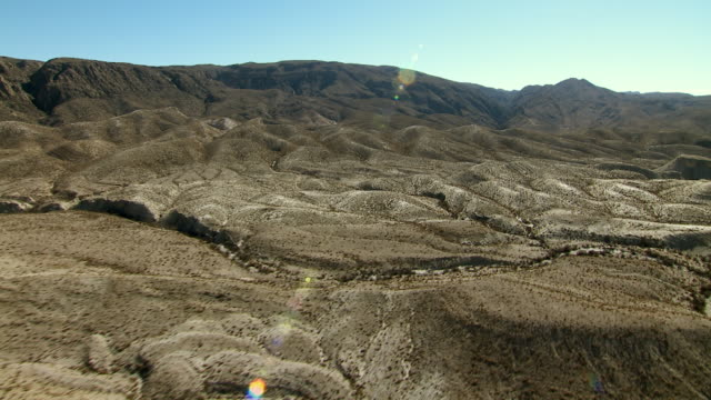 Dry creekbeds or arroyos lie nestled among the furrowed foothills of Mariscal Mountain in Big Bend National Park.