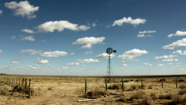 Dry grasslands windmill cloudscape time-lapse Yuma County prairie Colorado