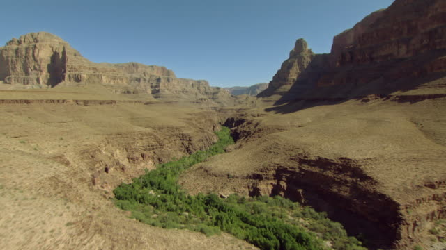 a dry riverbed cuts through the interior of the grand canyon. - riverbed stock videos & royalty-free footage