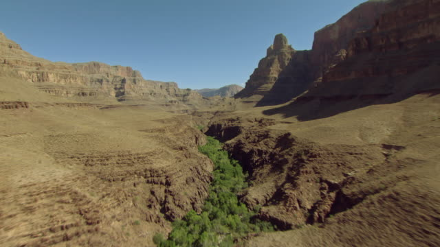 a dry riverbed winds through the interior of the grand canyon. - riverbed stock videos & royalty-free footage