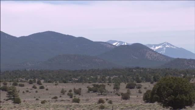 dry scrubland skirts volcano ridge near flagstaff, arizona. - shrubland stock videos & royalty-free footage