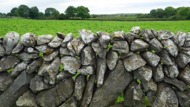 dry stone wall ln burren landscape in ireland - stone wall stock videos and b-roll footage