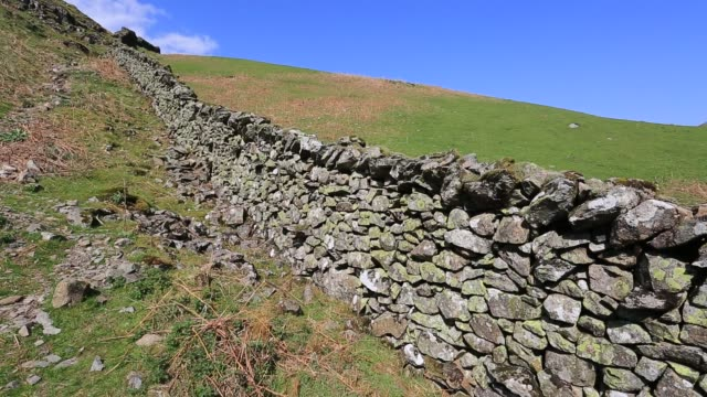 dry stone walling pattern. - stone wall stock videos & royalty-free footage