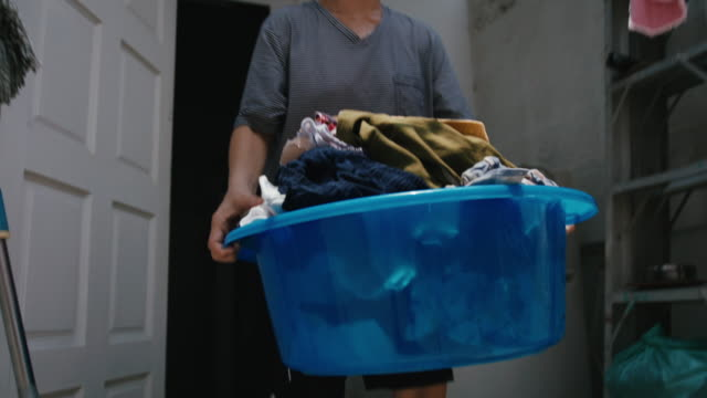 dry the clothes - washing line stock videos & royalty-free footage