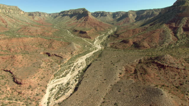 a dry wash runs through the grand canyon. - riverbed stock videos & royalty-free footage