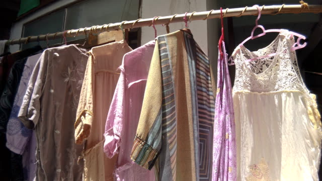 drying clothes by cloth racks, keeping clothing drying on clothes rack, cloth hangers in used - drying rack stock videos and b-roll footage