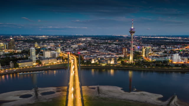 düsseldorf cityscape at night - aerial hyperlapse - river rhine stock videos & royalty-free footage