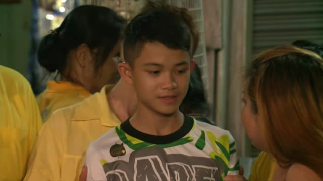 duangpetch promthep, one of the soccer players rescued from the tham luang cave in thailand, reunites with his relatives on july 18, 2018 in mae sai,... - thailand stock videos & royalty-free footage