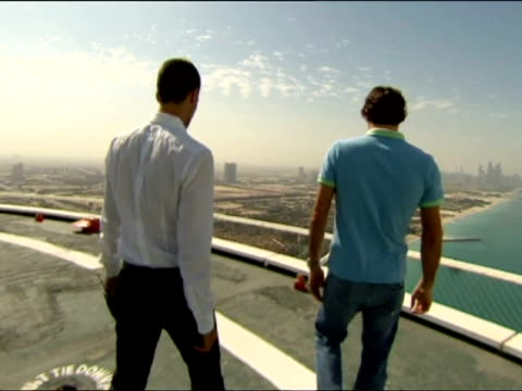 dubai 27 feb roger federer and novak djokovic take part in a special photo shoot at the helipad of the luxuxry hotel burg al arab and other... - 2012 stock videos & royalty-free footage
