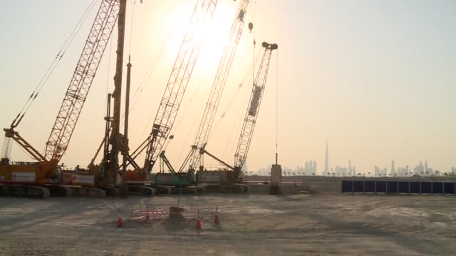 dubai began construction work monday on a tower that will stand higher than its burj khalifa which is currently the world's tallest skyscraper - tall high stock videos and b-roll footage