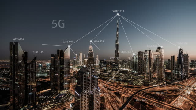 t/l dubai city skyline and 5g network concept, from day to night / uae - smart city stock videos & royalty-free footage