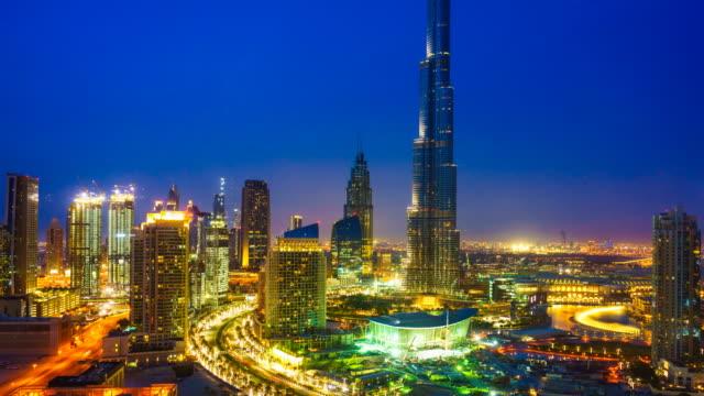 Dubai cityscape and Burj Khalifa, day to night time lapse