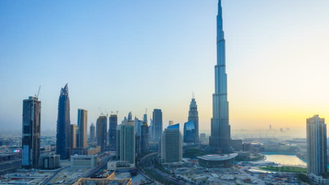dubai cityscape and burj khalifa, sunrise time lapse - busy morning stock videos & royalty-free footage
