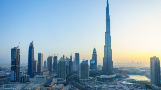dubai cityscape and burj khalifa, sunrise time lapse - sunrise dawn stock videos and b-roll footage