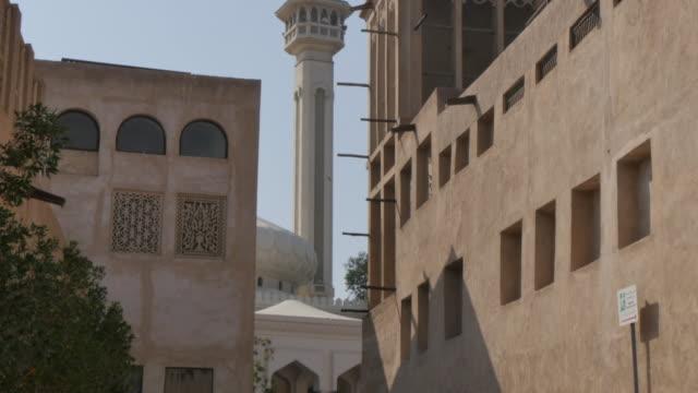 dubai grand mosque and buildings of the al fahidi historical neighbourhood, dubai, united arab emirates, middle east, asia - minaret stock videos and b-roll footage