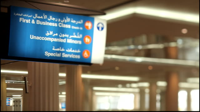 dubai international airport. tilt-shift view of a sign for first and business class inside a terminal building at the airport. - business travel stock videos & royalty-free footage