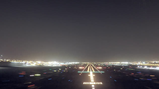 dubai intl. airport, approach and landing (pov shot nighttime) - landing touching down stock videos & royalty-free footage