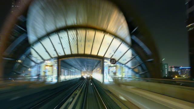 4k dubai metro by night - monorail stock videos and b-roll footage