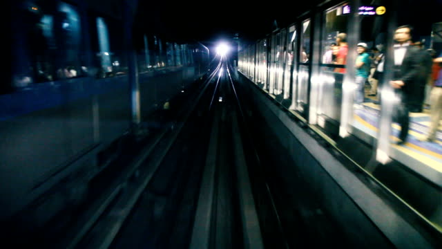 dubai metro train running fast in the tunnel - underground rail stock videos & royalty-free footage
