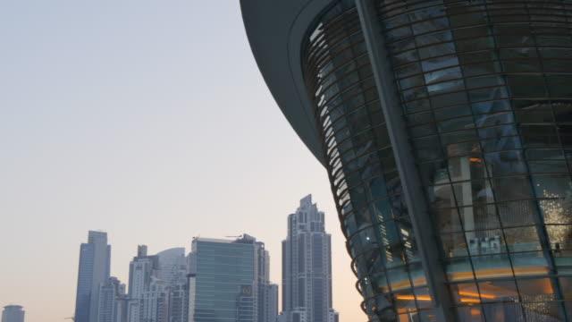 dubai opera house from burj khalifa lake at dusk in downtown, dubai, united arab emirates, middle east, asia - opera stock videos & royalty-free footage