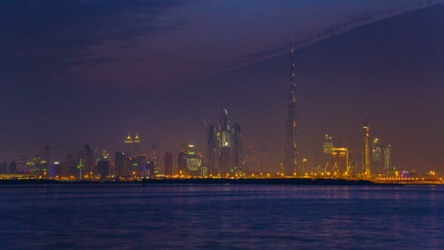 TL WS Dubai Skyline across Dubai Creek Harbour at night