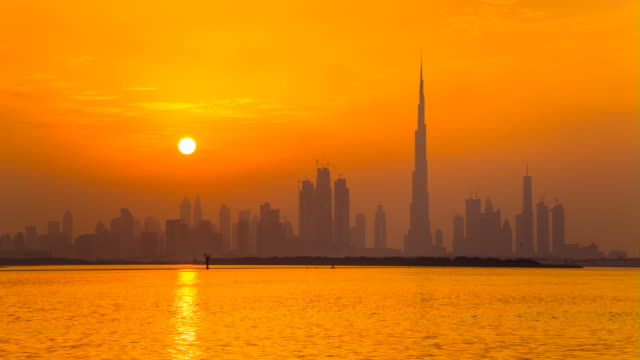tl ws dubai skyline across dubai creek harbour at sunset - dubai stock videos & royalty-free footage