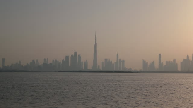 dubai skyline across water uae on sunday june 10 2018 - international landmark stock videos & royalty-free footage