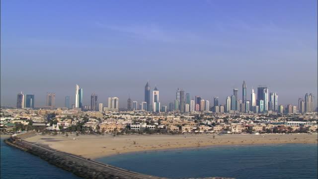 AERIAL Dubai skyline along coast, Dubai, United Arab Emirates