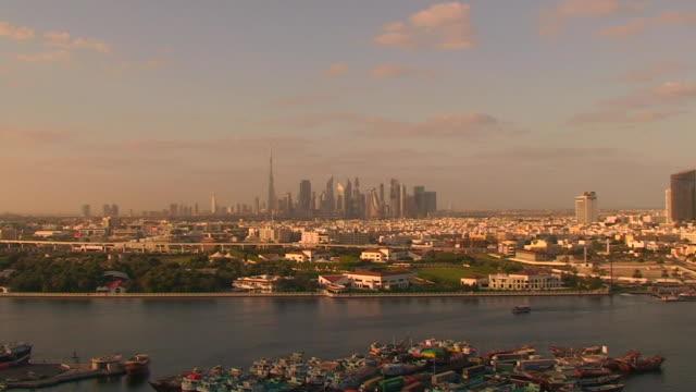 dubai skyline at sunset - film montage stock videos & royalty-free footage