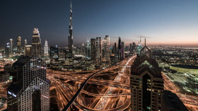 t/l zo dubai skyline, day to night transition / dubai, uae - skyline stock videos & royalty-free footage