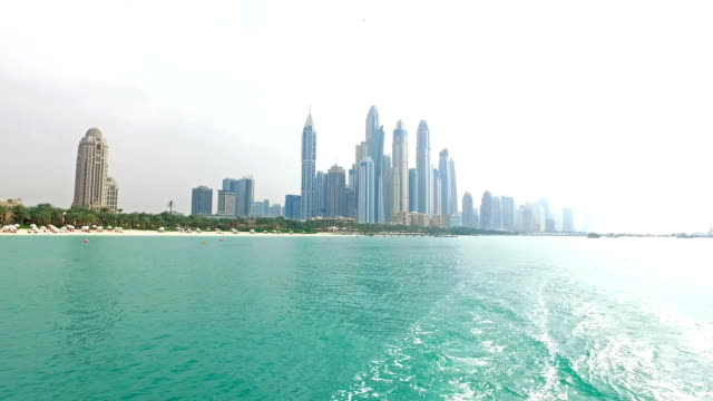 dubai skyline from the sea - pjphoto69 stock videos & royalty-free footage